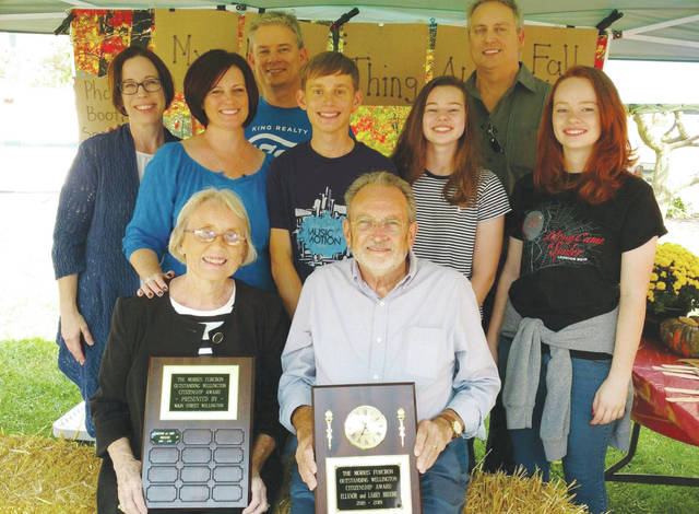 Larry and Eleanor Broome are surrounded by family members Sept. 30 after being named the first recipients of the Morris Furcron Outstanding Wellington Citizenship Award.