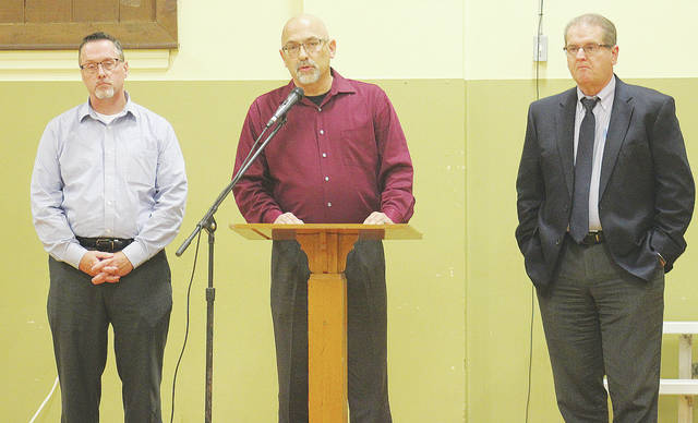 Village manager Steve Dupee, mayor Hans Schneider, and village council president Gene Hartman advocate for Issue 34 during a candidates night at town hall.