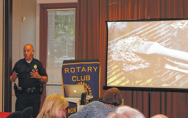 <strong>Englewood Police Sgt. Mike Lang discussed his passion for grilling, photography and barbecue recipes at a recent meeting of the Northmont Rotary Club.</strong>