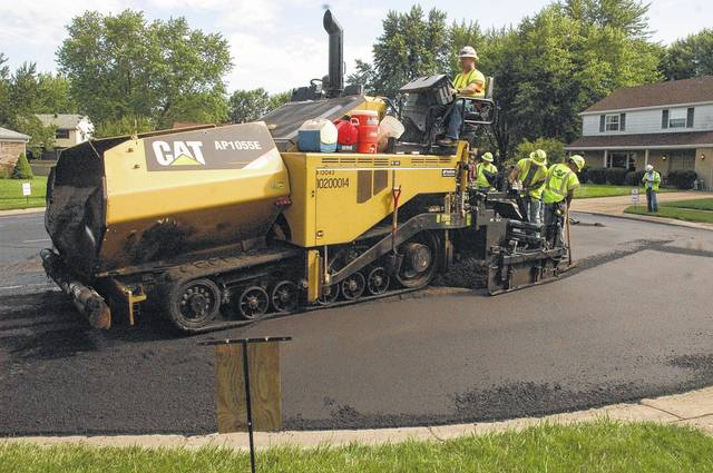 <strong>Workers with the John R. Jurgensen Company are shown repaving Colby Way in Englewood early Monday morning.</strong>