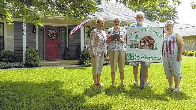 <strong>The July City Beautiful Award winners are Ray and Sandy McDonald of 200 Fivepines Court. They have lived in this house for 7 years with their two cats. The McDonald's enjoy working on their yard and have recently added a new deck and picket fence in the backyard. Ray worked for DP&L for 43 years and Sandy previously worked in a doctor's office and for a carpet store. Pictured with the McDonalds are Donna Alexander (left) and Jeri Amos (right).</strong>