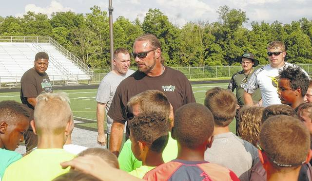 <strong>Northmont Varsity Head Coach Tony Broering describes some of the drills players will be taking part in during a group meeting.</strong>