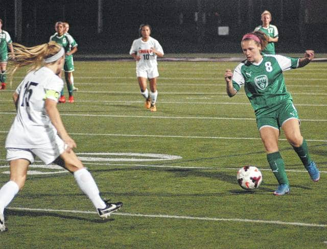 <strong>Alyssa Saltsman tries to move the ball past midfield as Taylor Ulrich moves up to defend.</strong>