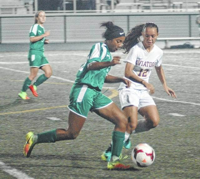 <strong>Aviana Ewing moves the ball down the field as Anna Miner defends.</strong>