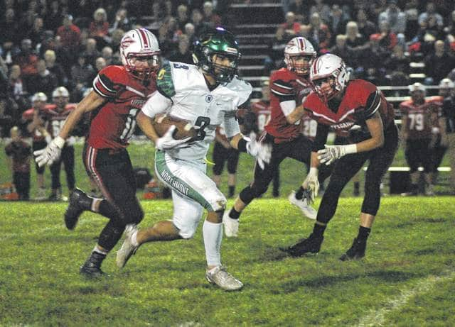 <strong>Drake Hickman breaks loose to complete an 85 yard touchdown catch from Miles Johnson on first down at Tipp City.</strong>