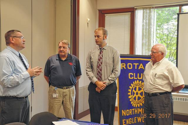 <strong>Pictured (left to right) is Scott Rolfes, Rotary Membership Chairman, providing the induction; Mike Barrow, new member sponsor; Brad Rarick and Walter Harrison.</strong>