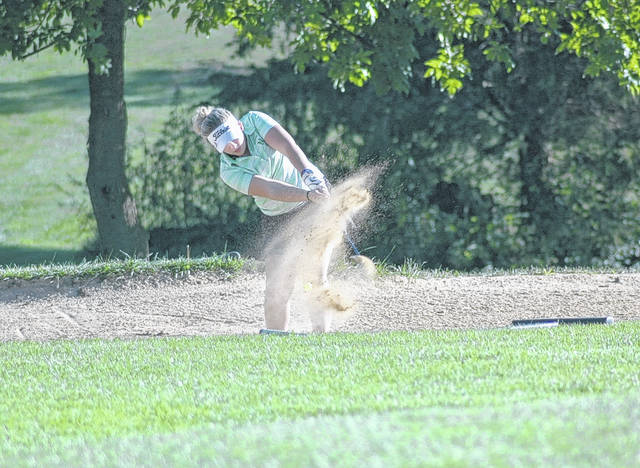 <strong>Senior Ashley Singer hits out of a bunker on Hole 7 against Miamisburg. </strong>