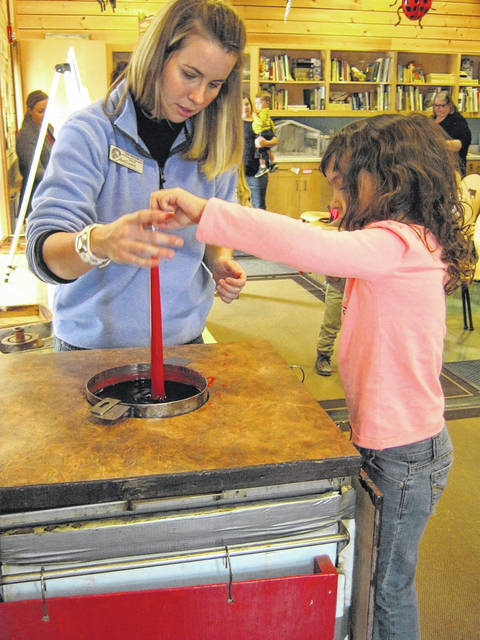 <strong>Traditional candle dipping using beeswax creates special memories at Aullwood. Learn about candles, bees, lighting and conservation in this fun hands-on program Saturdays and Sundays, November 4, 5, 11, 12, 18, 19, and 25, 26 starting at 2:30 p.m.</strong>
