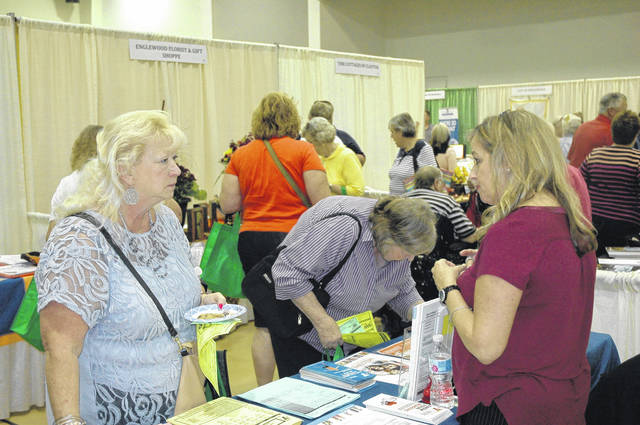 <strong>Local resident Mary Henning visits the YMCA booth at the annual Northmont Area Chamber of Commerce Business Expo.</strong>