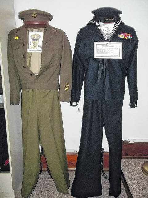 <strong>The Army uniform on the left belonged to Robert Woolery, a sergeant with the 20th Repair Squadron of the 20th Air Depot Group. The Navy uniform on the right was worn by Harold Hogar, who served in the Panama Canal Zone aboard the USS Roosevelt.</strong>