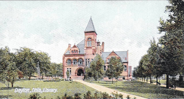 <strong>This Gothic sandstone building in Cooper Park housed the Dayton library from 1888 to 1962. The brick building that replaced it underwent several renovations, during which everything but the restrooms moved. Even the front door moved from Third Street to St. Clair Street after one renovation. It finally yielded to the new brick and glass building that opened on Aug. 5. (Photo from RTHS archives.)</strong>