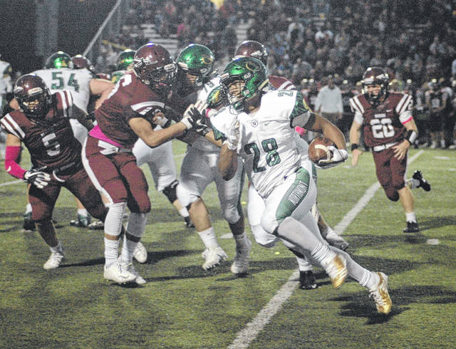 <strong>Devin Kenerly picks up yardage to give Northmont a first down deep in Miamisburg territory as a helmetless Jon Hardin pursues.</strong>