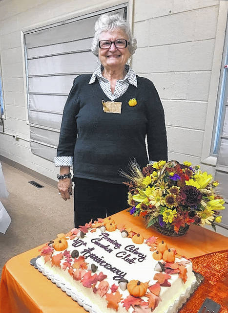 <strong>Morning Glory Garden Club Charter Member Sharon Walker poses with a cake recognizing the club's 40<sup>th</sup> anniversary.</strong>