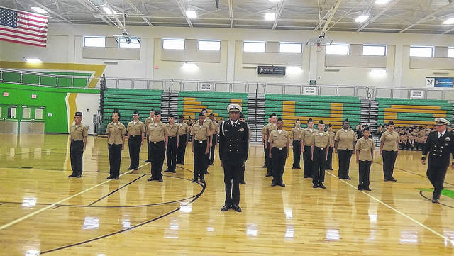 <strong>Cadet A. Williams with his platoon ready for inspection as CDR Hankins approaches.</strong>