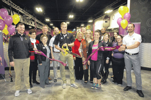 <strong>Planet Fitness in Northmont Plaza held its ribbon cutting on Wednesday, Nov. 1. Pictured left to right is Planet Fitness employee Mike McKenna, Englewood Mayor Patricia Burnside, Northmont Chamber CEO Cathy Hutton, Englewood Development Director Bill Singer, Planet Fitness personnel Adam Hintz and Damian Mackessy (scissors), Chambers members Missy Renner, Steve Henne, and Cathy McGrail, Biggest Loser star Dani Allen, Dayton Boys & Girls Club CEO Terence Hayes, Chamber member Lisa Nussman, and Planet Fitness personnel Ashley Sanborn, Effie Neff and Steven Reider.</strong>