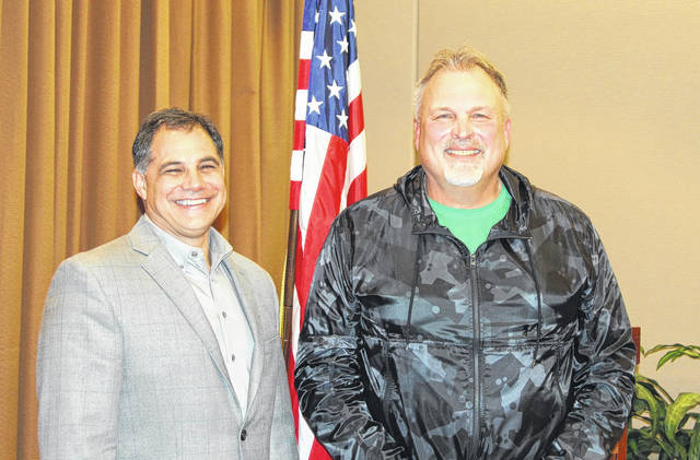 <strong>Scott Newburg (right) is shown with Rotary member Northmont Superintendent Tony Thomas.</strong>