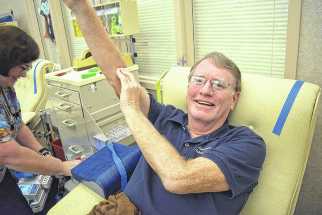 <strong>Clayton donor Dr. Steve Dicke made his milestone 100th lifetime blood donation Thursday, Nov. 9.</strong>