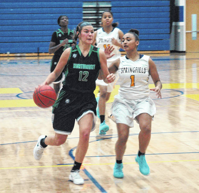 <strong>Anna Mangen drives for a score after coming up with a steal late in the first quarter at Springfield.</strong>