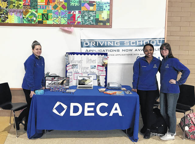 <strong>Pictured left to right are DECA students Emily Frantz, Naomi Admasu, and Julia Presley.</strong>