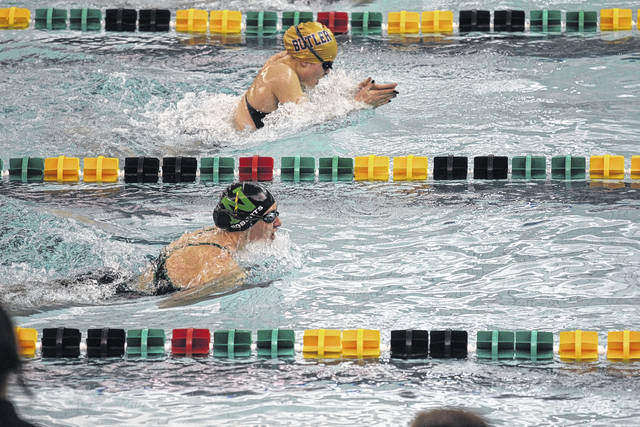 <strong>Northmont's Fynn Roberts overtakes Butler's Sydney Baker to take first in 100 yard breast stroke.</strong>