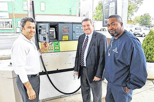 <strong>Phillipsburg Fuel manager Vik Rutherford (left) shows Auditor Karl Keith and Chief Inspector Joe Harris the new locks on his pumps.</strong>