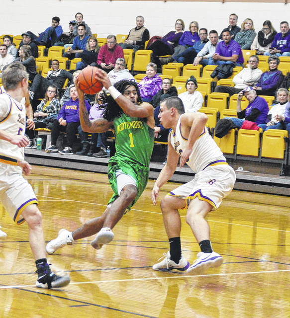 Jabari Perkins (1) drives down the lane during Northmont's game at Butler on Tuesday.