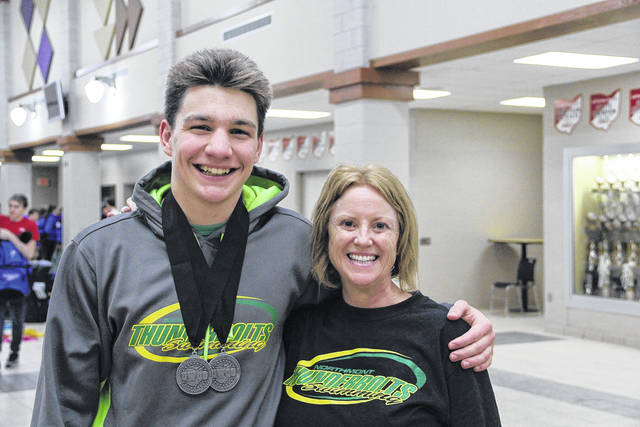<strong>Justin DeLano with Coach Maria Schreiber, after receiving two second place medals at the GWOC National League swim meet</strong>