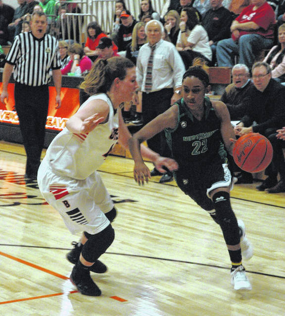 <strong>Salena Roberts drives past Lexi Moore as Beavercreek Coach Ed Zink looks on.</strong>
