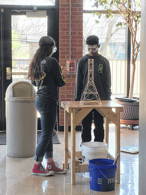 <strong>Northmont Middle School Science Olympiad team members Jocelynn Asbra and Jordan Tucker set up for the Towers event competition during the Bardstown, KY Invitational last Saturday.</strong>