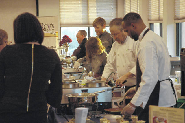 <strong>Chefs with Brookdale Senior Living Solutions prepare food plates for guests at the &#8216;Taste of Northmont.&#8217;</strong>