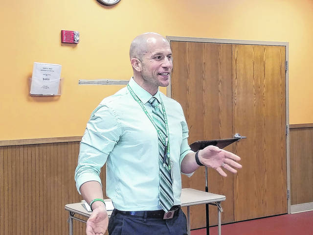 <strong>Northmont High School Faculty Member Chris Zink discussed details about the Latchkey Program offered through Northwood Elementary School at the recent meeting of the Northmont Rotary Club.</strong>