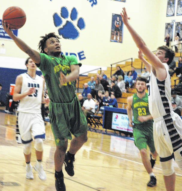 <strong>Danny Lewis goes in for a layup against Springboro.</strong>
