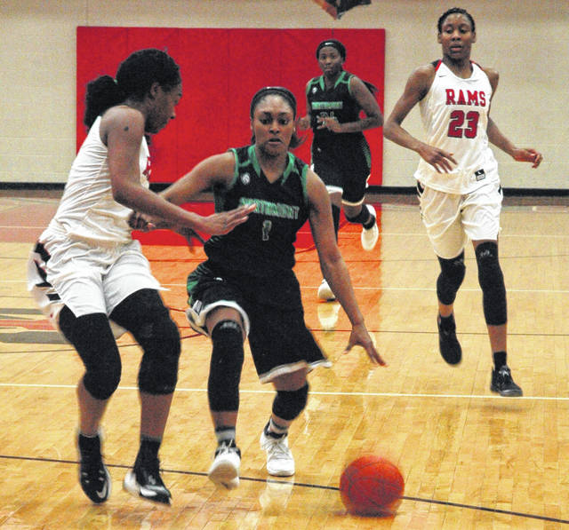 <strong>After stealing the ball from Shai McGruder (23) Makayla Cooper storms down the court. Cooper led Northmont with 20 points.</strong>