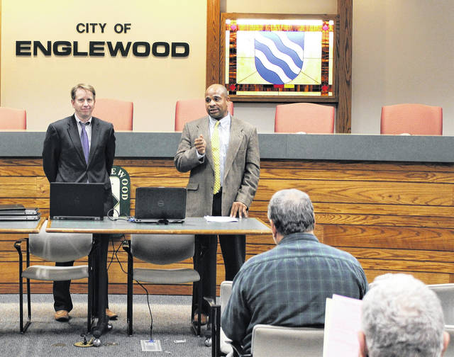 <strong>Real Estate Director Doug Trout and Board of Revision Hearing Officer Alonzo Edmonds speak with residents at Englewood City Hall.</strong>