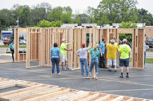<strong>Volunteers help to frame a house during the 2017 house building event held in the Concord United Methodist Church parking lot.</strong>