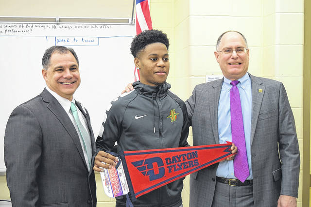 <strong>Cameron Rucker is pictured with University of Dayton President Eric Spina (right) and Northmont Superintendent Tony Thomas.</strong>