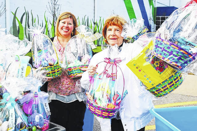 <strong>Dayton Catholic Women&#8217;s Club members Sunny Lain (left) and Ruth Galyon helping to deliver Easter baskets to the St. Vincent de Paul Shelter on Monday, March 26.</strong>