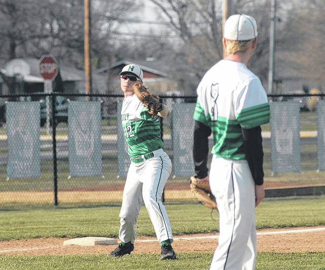 <strong>Third baseman Austin Weaver throws to first base to get Waynesville batter Austin Fannin out. Weaver recorded all three outs in the top of the third inning, the last on a diving stop to short on a hard hit ground ball by Landon Beachler to end the inning.</strong>