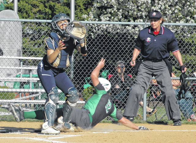 <strong>D.J. Shepherd slides in to score Northmont&#8217;s first run against Fairmont.</strong>