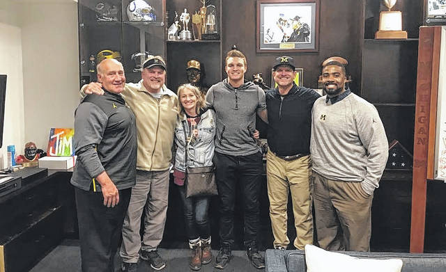 <strong>Pictured left to right: University of Michigan Defensive Line Coach Greg Mattison, Scott Newburg, Katy Newburg, Gabe Newburg, Head Coach Jim Harbaugh, and Linebackers Coach Al Washington.</strong>