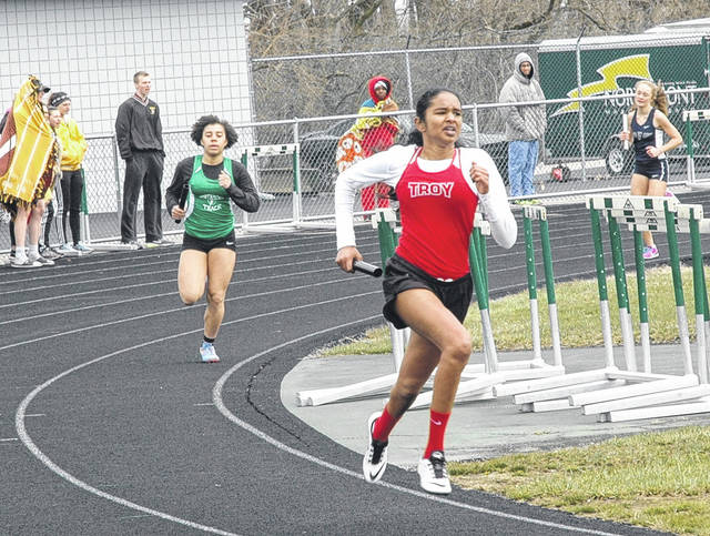 <strong>Troy's Alekyha Gollamudi (right) heads toward the back straight ahead of Northmont's Katie McCrary during the girls 4x400 meter relay.</strong>