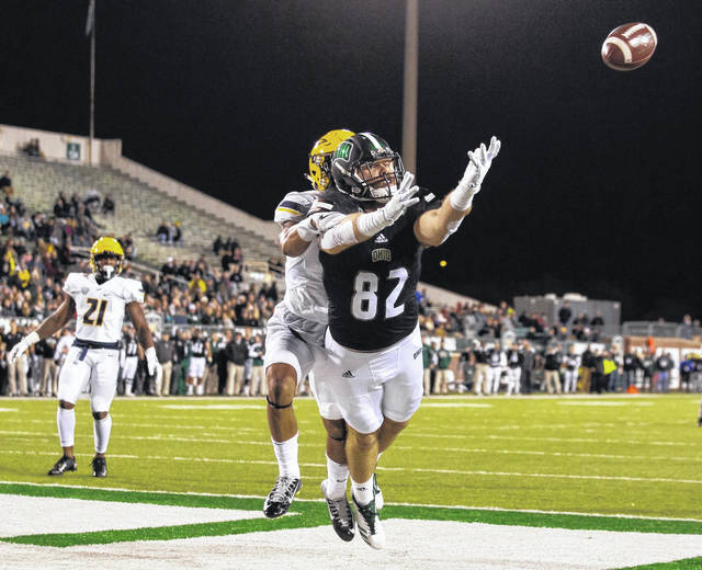 <strong>Troy Mangen dives for a catch in the end zone while playing for Ohio University.</strong>