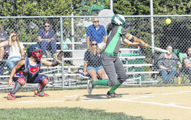 <strong>Cassy Lewis hits a bloop single over shortstop in the bottom of the 2<sup>nd</sup> inning.</strong>