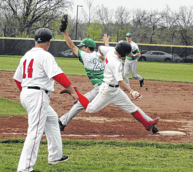 <strong>Ryan Pullins stretches to take a throw from third baseman Ryan Tanto to get Cole Kehl out at first by less than a foot as Wayne Assistant Coach Wayne Schroeder looks on.</strong>
