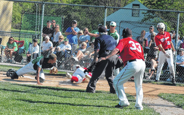<strong>Will Miller hangs on to the baseball after tagging out Wayne's Tyler Wynkoop at the plate in the top of the 3<sup>rd</sup> inning on a perfect throw to the plate by left fielder Garrett McGough.</strong>