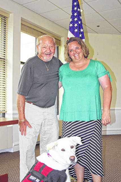 "Marvin Witters with his therapy dog ""Lucy"" and Kleptz Early Learning Center Guidance Counselor Nicki Tinnerman."