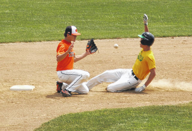 <strong>Chase Bickel steals second in the bottom of the 1<sup>st</sup> inning against Versailles.</strong>