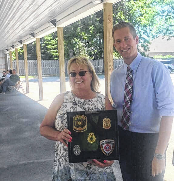 <strong>Paula Creech poses with Councilman Ken Henning and a plaque presented to her at a retirement party recently held at the Clayton Government Center.</strong>