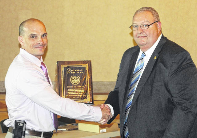 <strong>Rotarian of the Year David Wolfe is shown receiving his award from Brad Baughman.</strong>