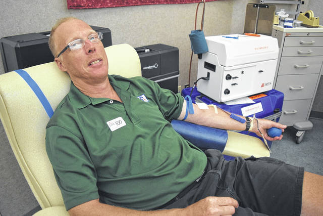 <strong>Union donor Thomas 'Tom' Ferdelman made his milestone 100th lifetime donation July 27 at the Dayton Community Blood Center.</strong>